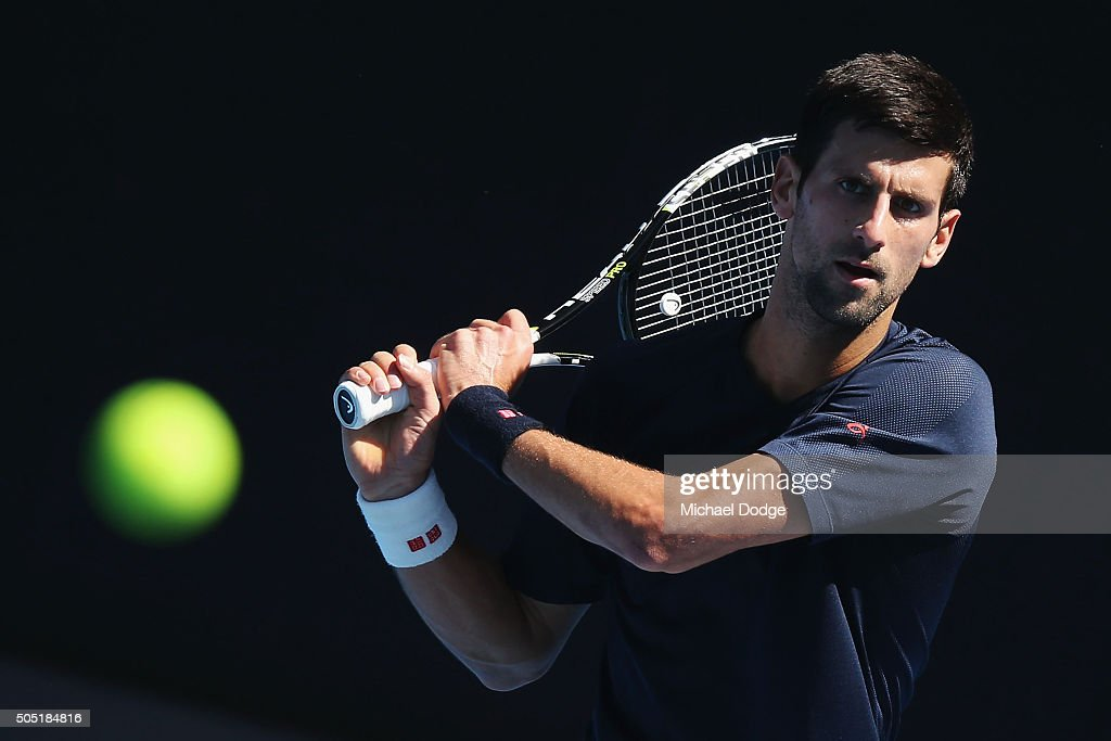 Novak Djokovic of Serbia hits a backhand during a practice session ahead of the 2016 Australian Open at Melbourne Park on January 16, 2016 in Melbourne, Australia.