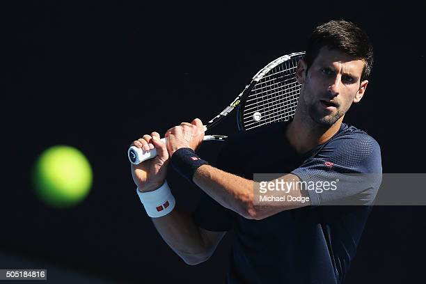 Novak Djokovic of Serbia hits a backhand during a practice session ahead of the 2016 Australian Open at Melbourne Park on January 16 2016 in...