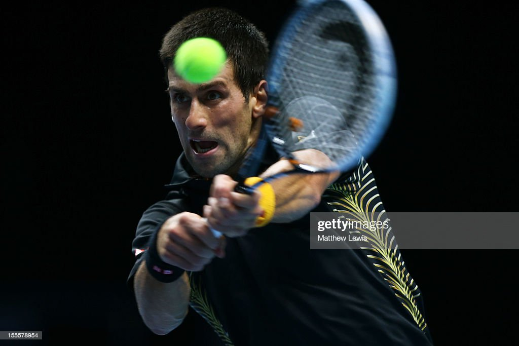 <a gi-track='captionPersonalityLinkClicked' href=/galleries/search?phrase=Novak+Djokovic&family=editorial&specificpeople=588315 ng-click='$event.stopPropagation()'>Novak Djokovic</a> of Serbia hits a backhand during the men's singles match against Jo-Wilfried Tsonga of France on day one of the ATP World Tour Finals at the O2 Arena on November 5, 2012 in London, England.