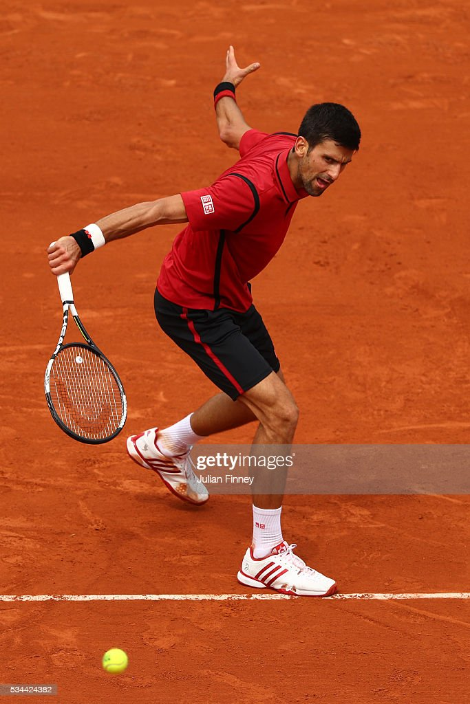 <a gi-track='captionPersonalityLinkClicked' href=/galleries/search?phrase=Novak+Djokovic&family=editorial&specificpeople=588315 ng-click='$event.stopPropagation()'>Novak Djokovic</a> of Serbia hits a backhand during the Men's Singles second round match against Steve Darcis of Belgium on day five of the 2016 French Open at Roland Garros on May 26, 2016 in Paris, France.