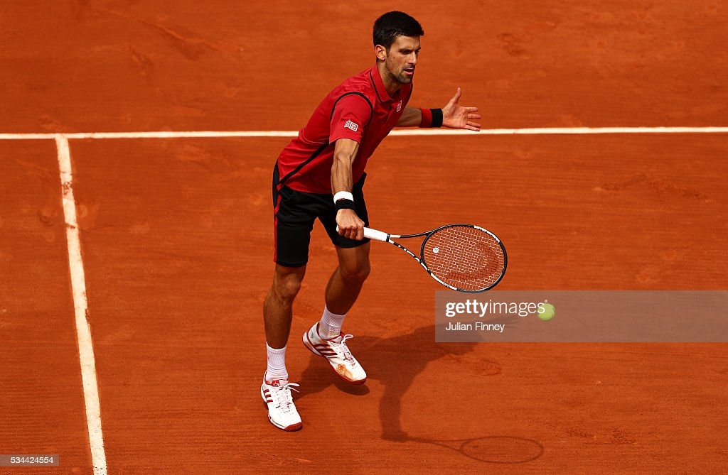 Novak Djokovic of Serbia hits a backhand during the Men's Singles second round match against Steve Darcis of Belgium on day five of the 2016 French Open at Roland Garros on May 26, 2016 in Paris, France.