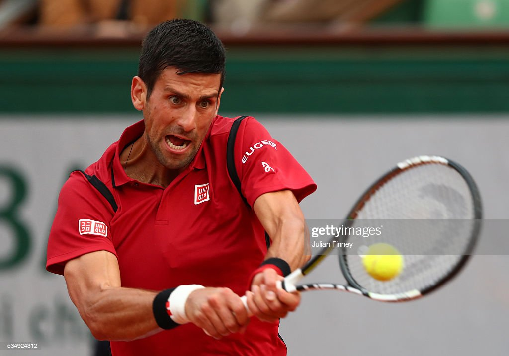 <a gi-track='captionPersonalityLinkClicked' href=/galleries/search?phrase=Novak+Djokovic&family=editorial&specificpeople=588315 ng-click='$event.stopPropagation()'>Novak Djokovic</a> of Serbia hits a backhand during the Men's Singles third round match against Aljaz Bedene of Great Britain on day seven of the 2016 French Open at Roland Garros on May 28, 2016 in Paris, France.