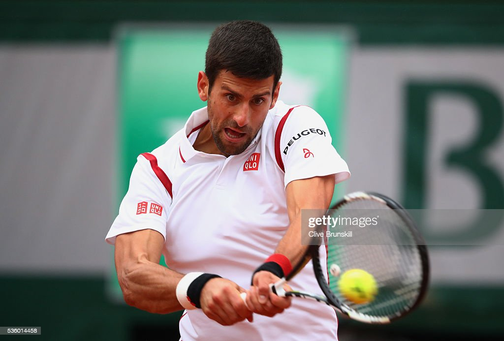 <a gi-track='captionPersonalityLinkClicked' href=/galleries/search?phrase=Novak+Djokovic&family=editorial&specificpeople=588315 ng-click='$event.stopPropagation()'>Novak Djokovic</a> of Serbia hits a backhand during the Men's Singles fourth round match against Roberto Bautista Agut of Spain on day ten of the 2016 French Open at Roland Garros on May 31, 2016 in Paris, France.