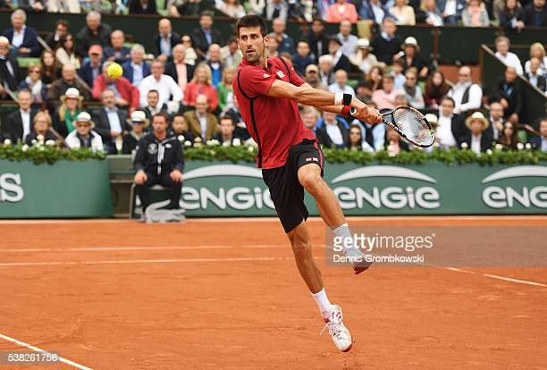 Novak Djokovic of Serbia hits a backhand during the Men's Singles final match against Andy Murray of Great Britain on day fifteen of the 2016 French...