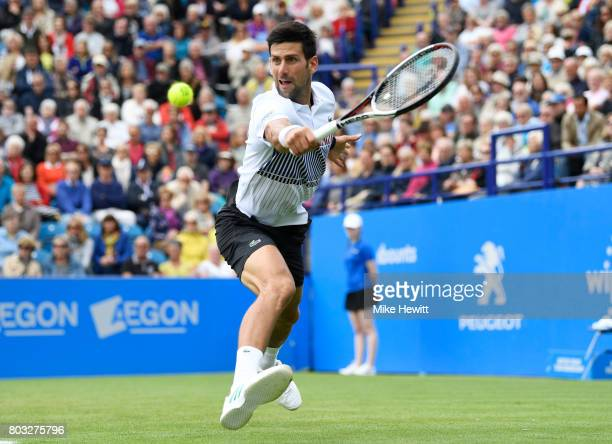 Novak Djokovic of Serbia hits a backhand during the men's singles quarter final match against Donald Young of The United States on day five of the...