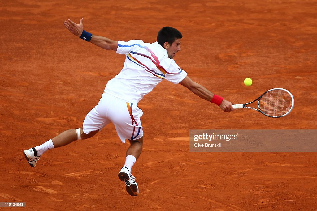 Novak Djokovic of Serbia hits a backhand during the men's singles semi final match between Roger Federer of Switzerland and Novak Djokovic of Serbia on day thirteen of the French Open at Roland Garros on June 3, 2011 in Paris, France.