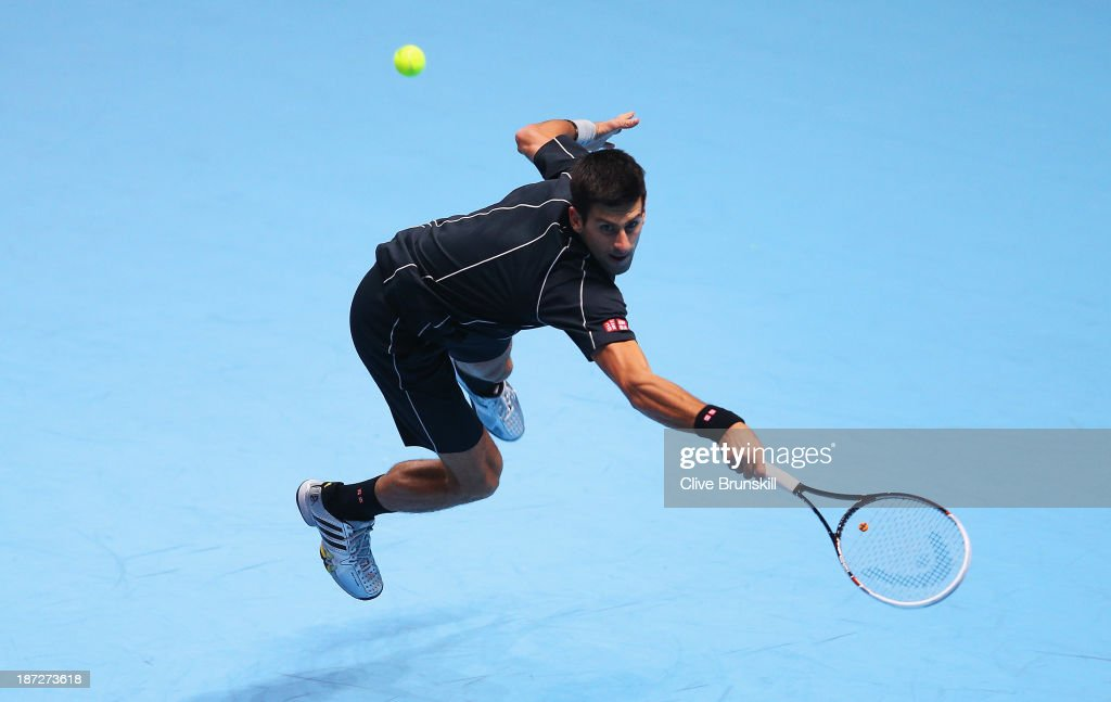 <a gi-track='captionPersonalityLinkClicked' href=/galleries/search?phrase=Novak+Djokovic&family=editorial&specificpeople=588315 ng-click='$event.stopPropagation()'>Novak Djokovic</a> of Serbia hits a backhand in his men's singles match against Juan Martin Del Potro of Argentina during day four of the Barclays ATP World Tour Finals at O2 Arena on November 7, 2013 in London, England.