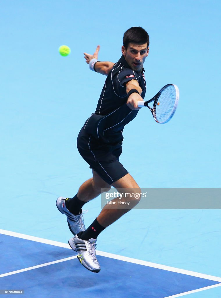 <a gi-track='captionPersonalityLinkClicked' href=/galleries/search?phrase=Novak+Djokovic&family=editorial&specificpeople=588315 ng-click='$event.stopPropagation()'>Novak Djokovic</a> of Serbia hits a backhand in his men's singles semi-final match against <a gi-track='captionPersonalityLinkClicked' href=/galleries/search?phrase=Stanislas+Wawrinka&family=editorial&specificpeople=557155 ng-click='$event.stopPropagation()'>Stanislas Wawrinka</a> of Switzerland during day seven of the Barclays ATP World Tour Finals at O2 Arena on November 10, 2013 in London, England.