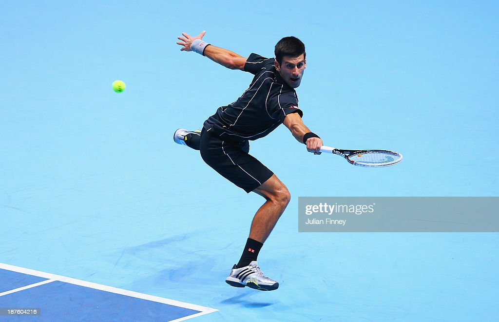 Novak Djokovic of Serbia hits a backhand in his men's singles semi-final match against Stanislas Wawrinka of Switzerland during day seven of the Barclays ATP World Tour Finals at O2 Arena on November 10, 2013 in London, England.