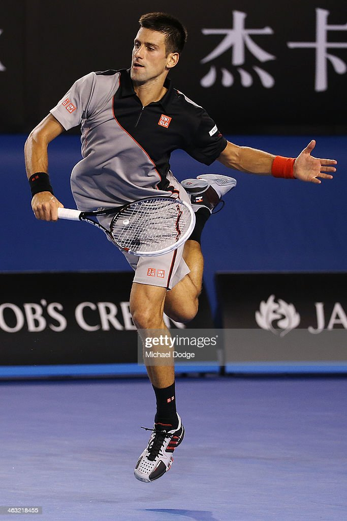 Novak Djokovic of Serbia hits a backhand in his third round match against Denis Istomin of Uzbekistan during day five of the 2014 Australian Open at Melbourne Park on January 17, 2014 in Melbourne, Australia.