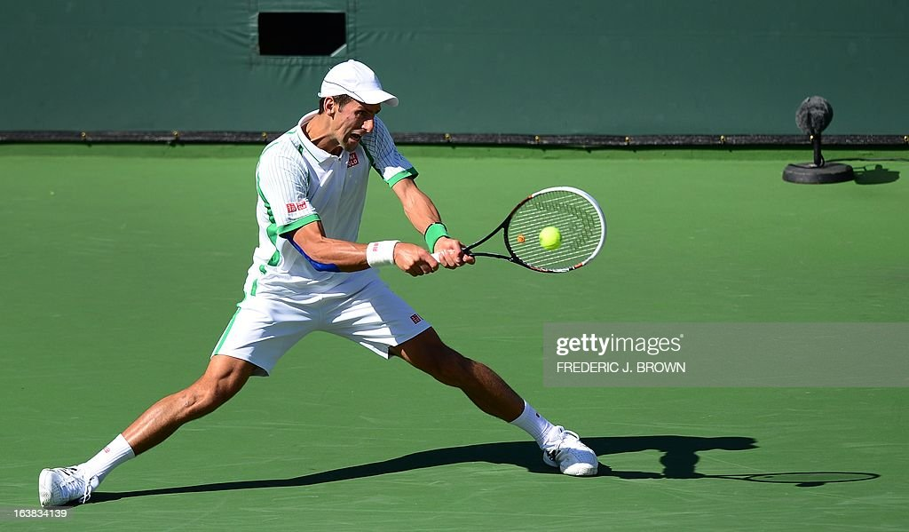 Novak Djokovic of Serbia hits a backhand return against Juan Martin Del Potro of Argentina on March 16, 2013 in Indian Wells, California, during their semifinal match at the BNP Paribas Open. AFP PHOTO/Frederic J. BROWN