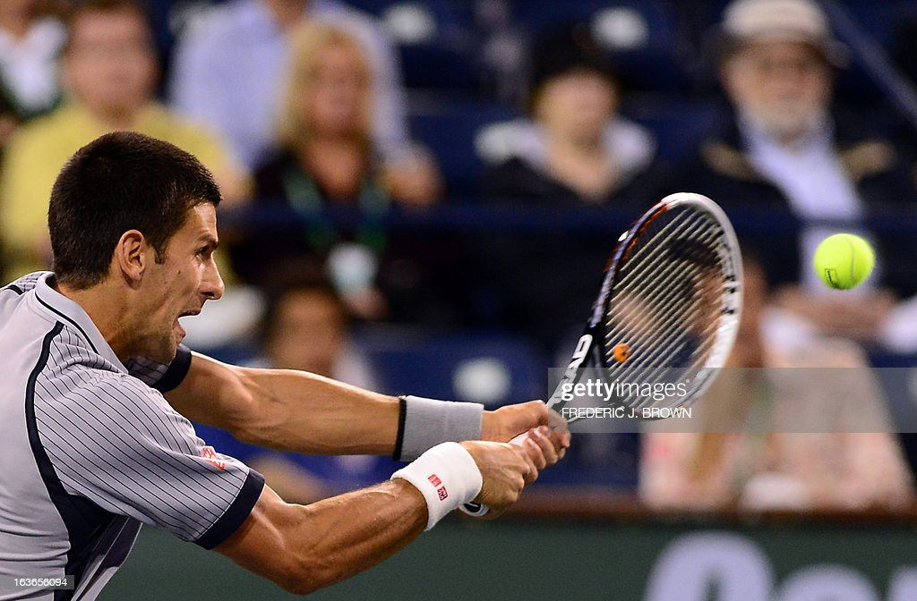 Novak Djokovic of Serbia hits a backhand return against Sam Querrey of the US during their ATP fourth round men's singles match at the BNP Paribas Open in Indian Wells, California early on March 14, 2013. AFP PHOTO/Frederic J. BROWN
