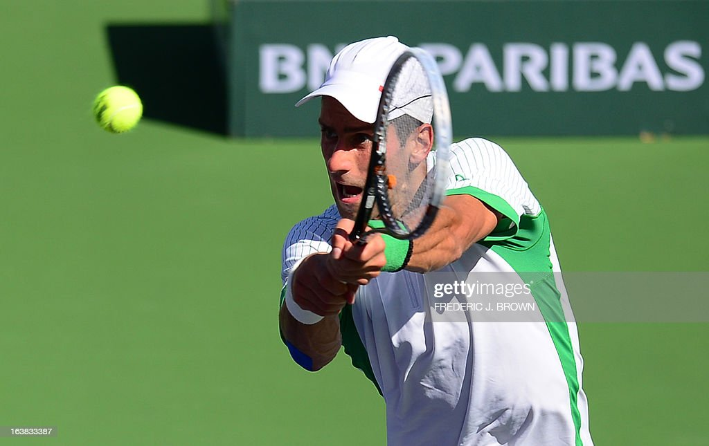 Novak Djokovic of Serbia hits a backhand return againstJuan Martin Del Potro of Argentina on March 16, 2013 in Indian Wells, California, during their semifinal match at the BNP Paribas Open. AFP PHOTO/Frederic J. BROWN