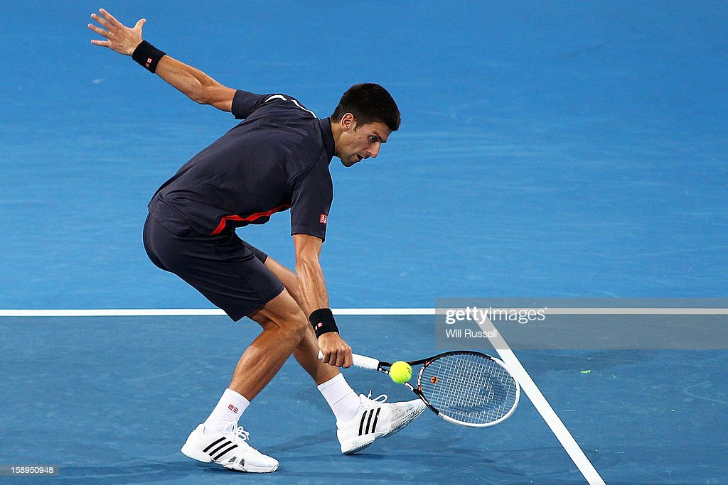 Novak Djokovic of Serbia hits a backhand shot in his mixed doubles match against Tatjana Malek and Thanasi Kokkinakis of Germany during day seven of the Hopman Cup at Perth Arena on January 4, 2013 in Perth, Australia.