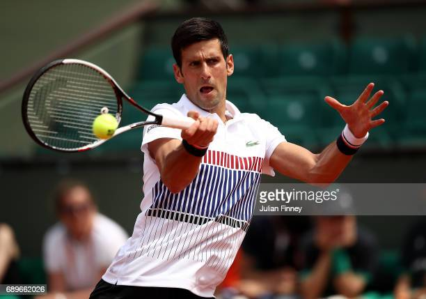 Novak Djokovic of Serbia hits a forehand during the first round match against Marcel Granollers of Spain on day two of the 2017 French Open at Roland...