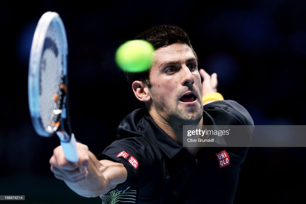 <a gi-track='captionPersonalityLinkClicked' href=/galleries/search?phrase=Novak+Djokovic&family=editorial&specificpeople=588315 ng-click='$event.stopPropagation()'>Novak Djokovic</a> of Serbia hits a forehand during the men's singles match against Jo-Wilfried Tsonga of France on day one of the ATP World Tour Finals at the O2 Arena on November 5, 2012 in London, England.