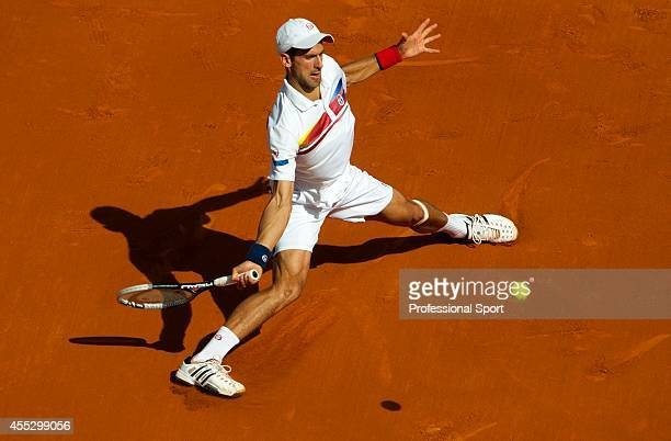 Novak Djokovic of Serbia hits a forehand during the men's singles round four match between Richard Gasquet of France and Novak Djokovic of Serbia on...