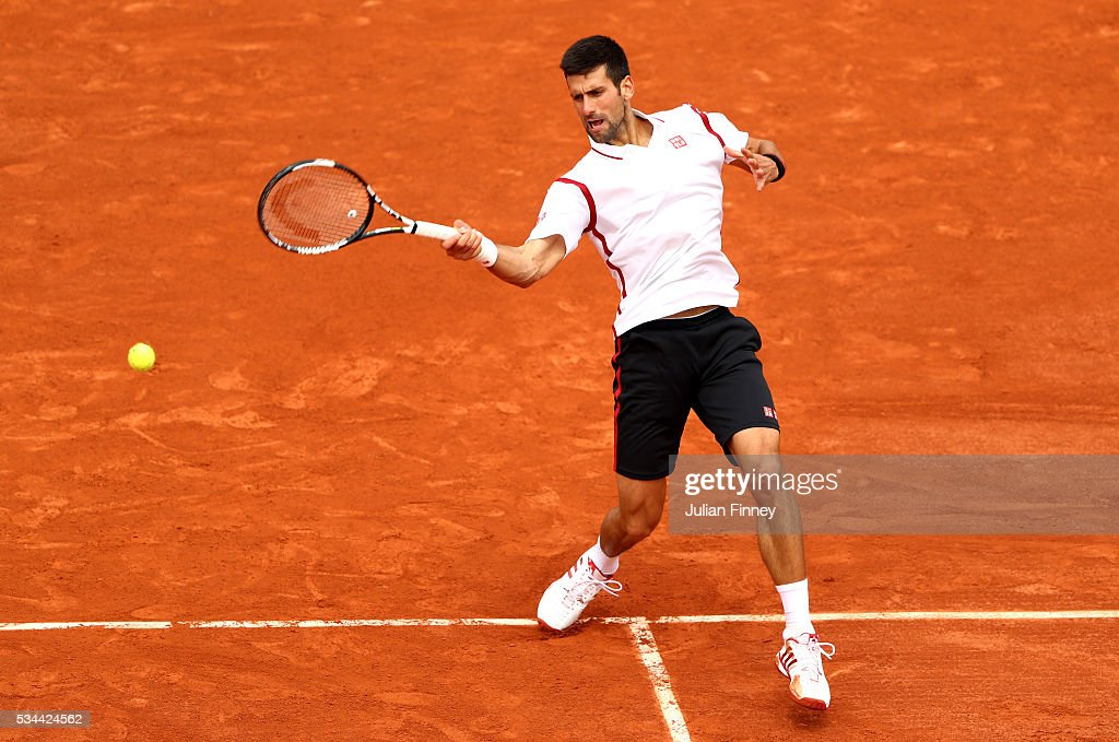 Novak Djokovic of Serbia hits a forehand during the Men's Singles second round match against Steve Darcis of Belgium on day five of the 2016 French Open at Roland Garros on May 26, 2016 in Paris, France.