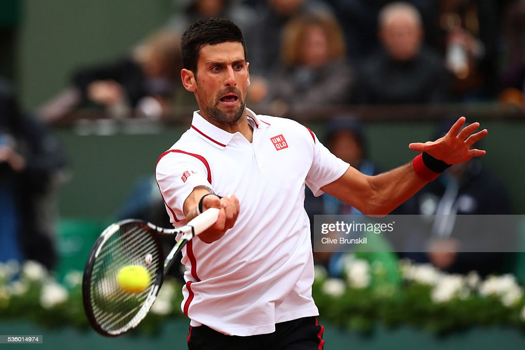 <a gi-track='captionPersonalityLinkClicked' href=/galleries/search?phrase=Novak+Djokovic&family=editorial&specificpeople=588315 ng-click='$event.stopPropagation()'>Novak Djokovic</a> of Serbia hits a forehand during the Men's Singles fourth round match against Roberto Bautista Agut of Spain on day ten of the 2016 French Open at Roland Garros on May 31, 2016 in Paris, France.