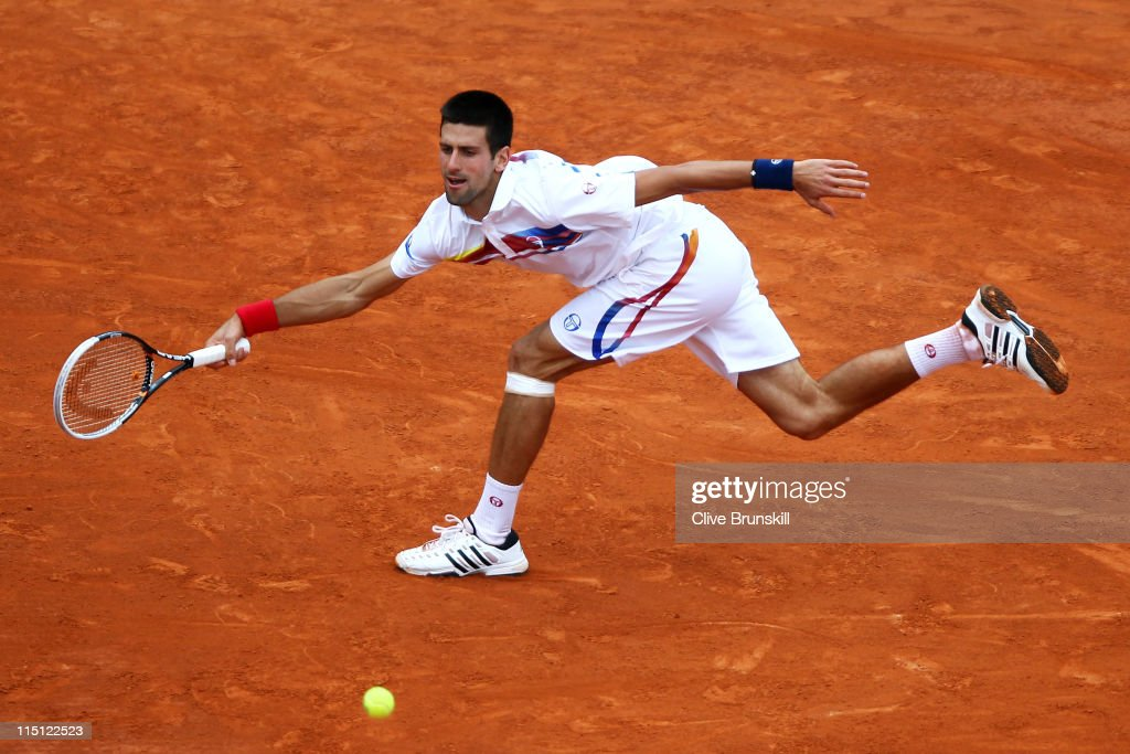 Novak Djokovic of Serbia hits a forehand during the men's singles semi final match between Roger Federer of Switzerland and Novak Djokovic of Serbia on day thirteen of the French Open at Roland Garros on June 3, 2011 in Paris, France.