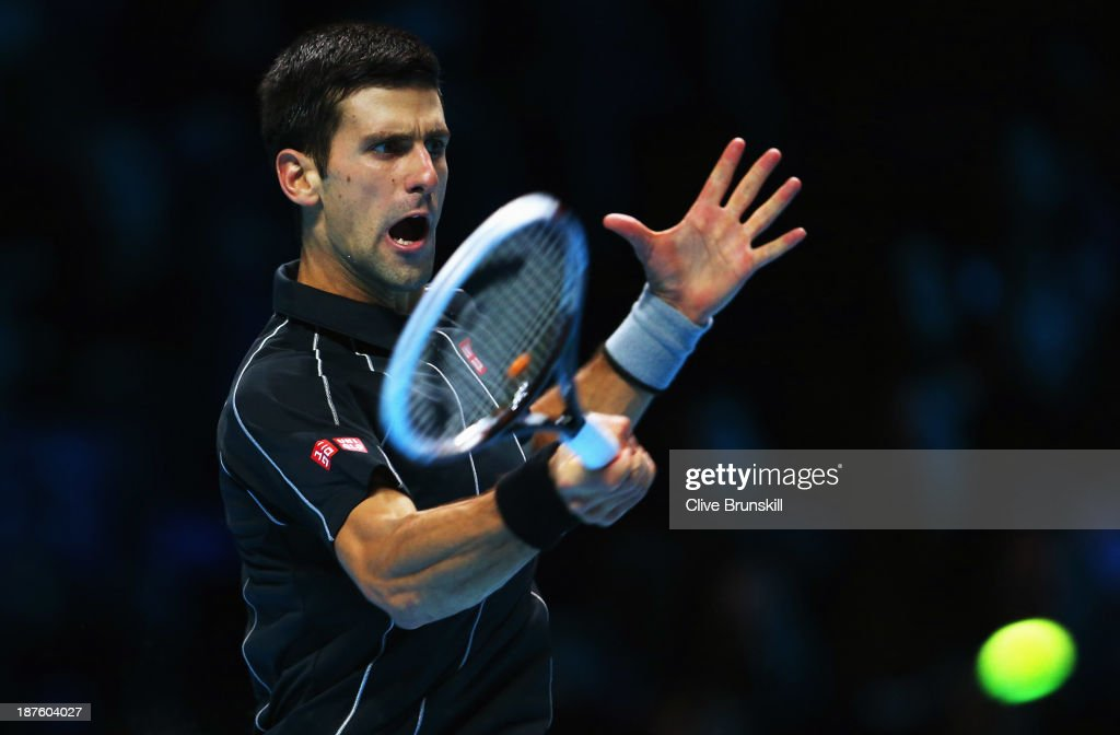 Novak Djokovic of Serbia hits a forehand in his men's singles semi-final match against Stanislas Wawrinka of Switzerland during day seven of the Barclays ATP World Tour Finals at O2 Arena on November 10, 2013 in London, England.