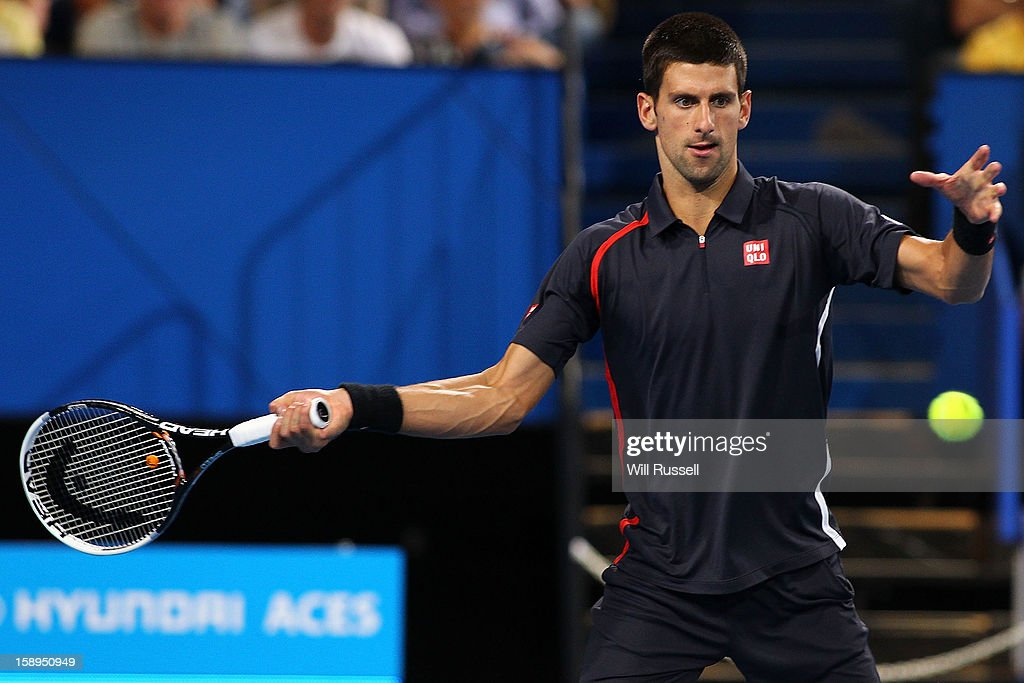 Novak Djokovic of Serbia hits a forehand shot in his mixed doubles match against Tatjana Malek and Thanasi Kokkinakis of Germany during day seven of the Hopman Cup at Perth Arena on January 4, 2013 in Perth, Australia.