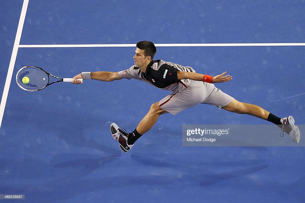 Novak Djokovic of Serbia hits a forehand volley in his third round match against Denis Istomin of Uzbekistan during day five of the 2014 Australian Open at Melbourne Park on January 17, 2014 in Melbourne, Australia.