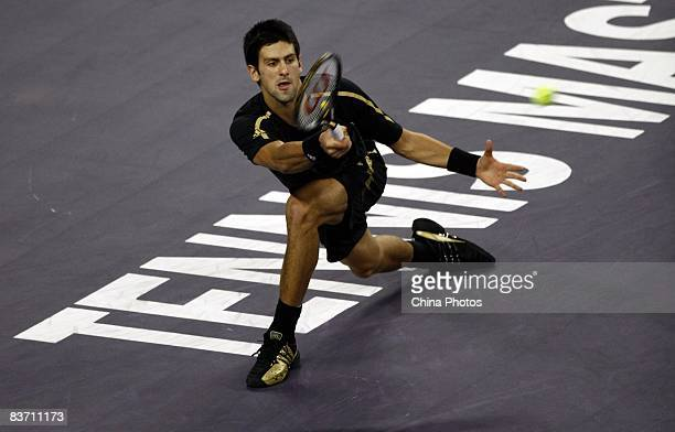 Novak Djokovic of Serbia hits a return against Nikolay Davydenko of Russia during the men's singles final match in the Tennis Masters Cup held at Qi...
