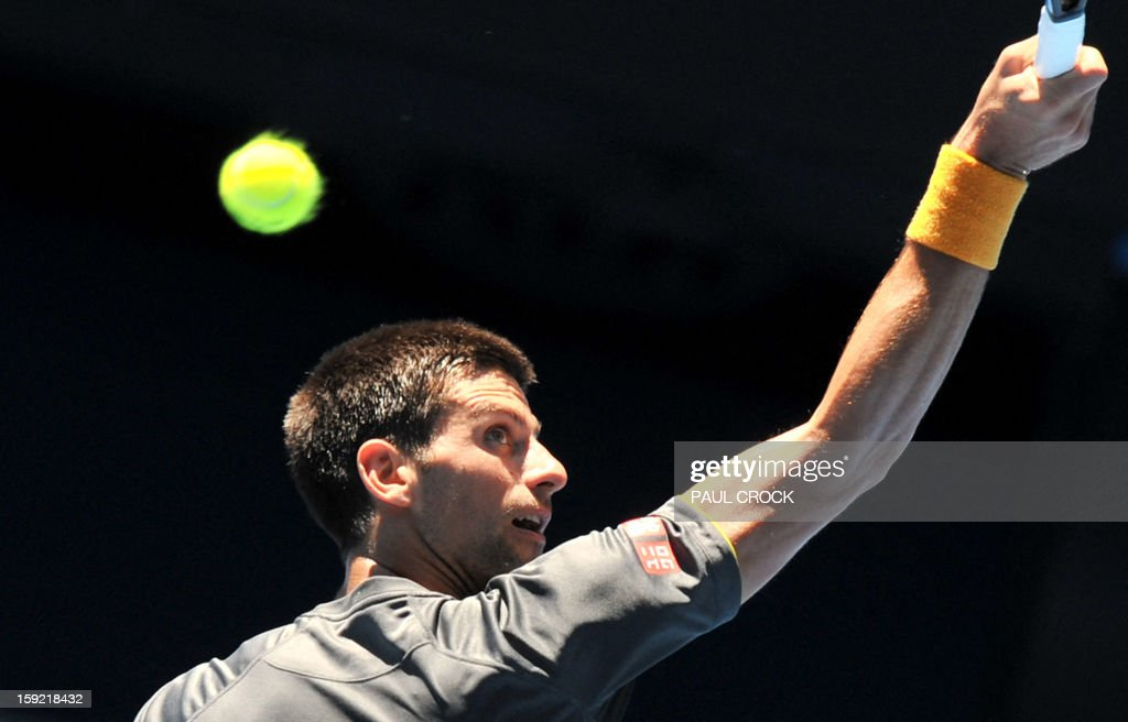 Novak Djokovic of Serbia hits a return during a practice session for the upcoming Australian Open tennis tournament in Melbourne on January 10, 2013. The first Grand Slam tennis tournament of the year is set to run from January 14 to 27. AFP PHOTO / Paul CROCK IMAGE