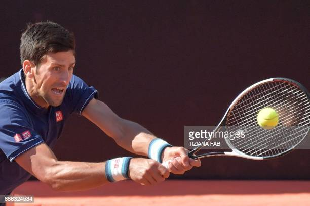 Novak Djokovic of Serbia hits a return to Alexander Zverev of Germany during the ATP Tennis Open final at the Foro Italico on May 21 2017 in Rome /...