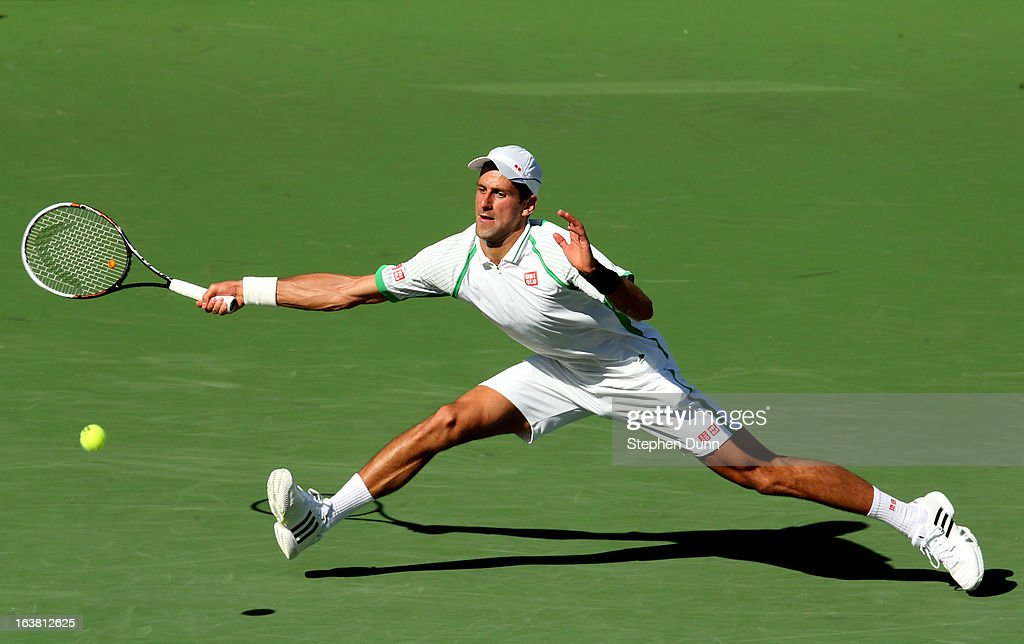 <a gi-track='captionPersonalityLinkClicked' href=/galleries/search?phrase=Novak+Djokovic&family=editorial&specificpeople=588315 ng-click='$event.stopPropagation()'>Novak Djokovic</a> of Serbia hits a return to Juan Martin del Potro of Argentina during the men's semifinal match of day 11 of the BNP Paribas Open at Indian Wells Tennis Garden on March 16, 2013 in Indian Wells, California.