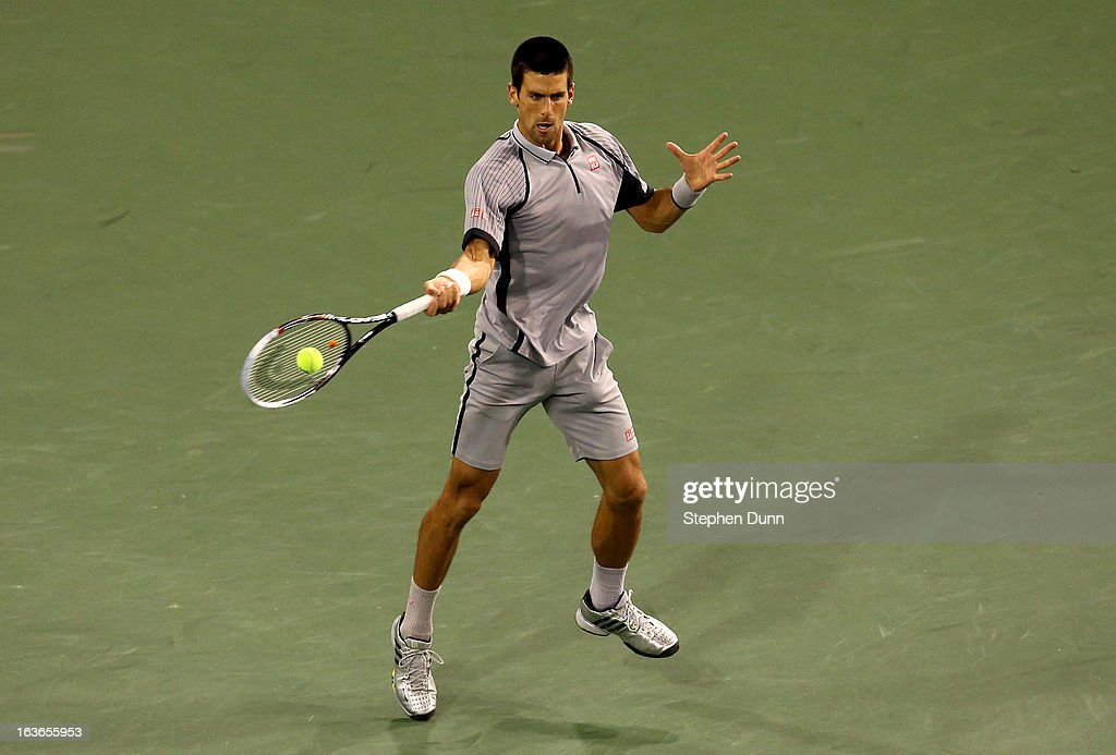 <a gi-track='captionPersonalityLinkClicked' href=/galleries/search?phrase=Novak+Djokovic&family=editorial&specificpeople=588315 ng-click='$event.stopPropagation()'>Novak Djokovic</a> of Serbia hits a return to Sam Querrey during day 8 of the BNP Paribas Open at Indian Wells Tennis Garden on March 13, 2013 in Indian Wells, California.