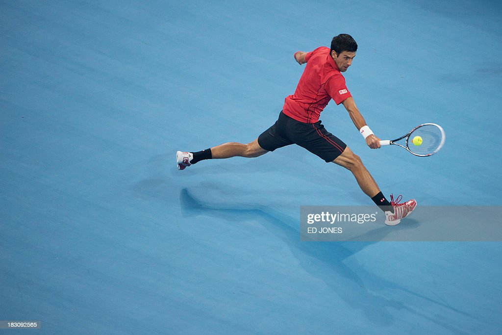 Novak Djokovic of Serbia hits a return to Sam Querrey of the US during their men's quarter final match at the China Open tennis tournament in Beijing on October 4, 2013. Djokovic won 6:1, 6:2. AFP PHOTO / Ed Jones