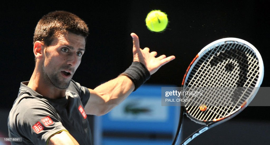 Novak Djokovic of Serbia hits a volley during a practice session for the upcoming Australian Open tennis tournament in Melbourne on January 10, 2013. The first Grand Slam tennis tournament of the year is set to run from January 14 to 27. AFP PHOTO / Paul CROCK IMAGE