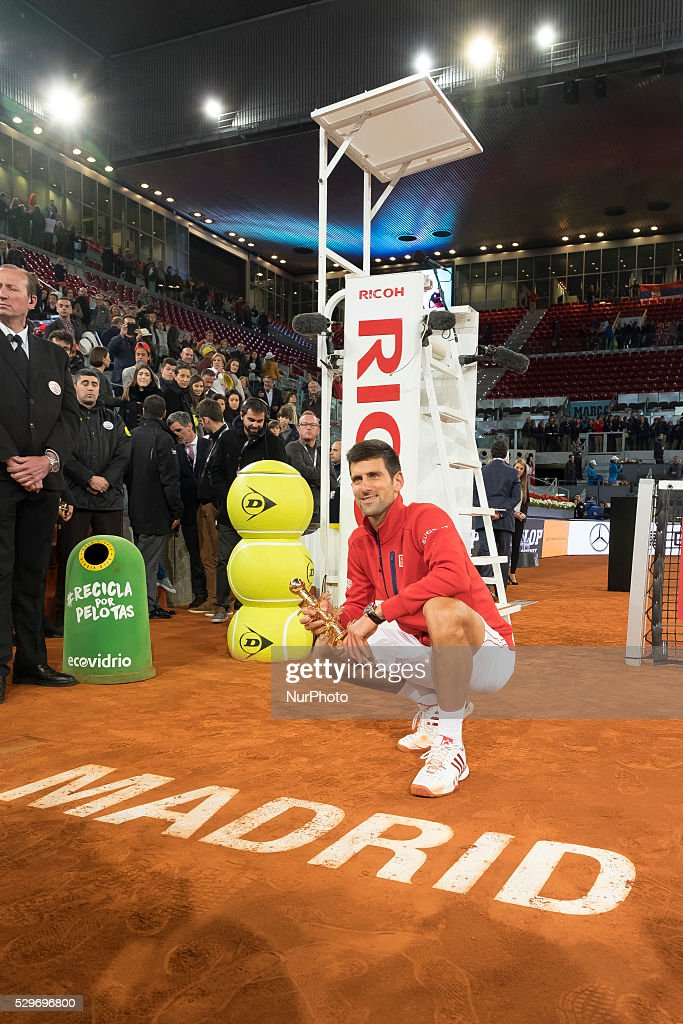 Novak Djokovic of Serbia holds aloft his winners trophy after his three set victory against Andy Murray of Great Britain in the mens final during day nine of the Mutua Madrid Open tennis tournament at the Caja Magica on May 08, 2016 in Madrid,Spain.