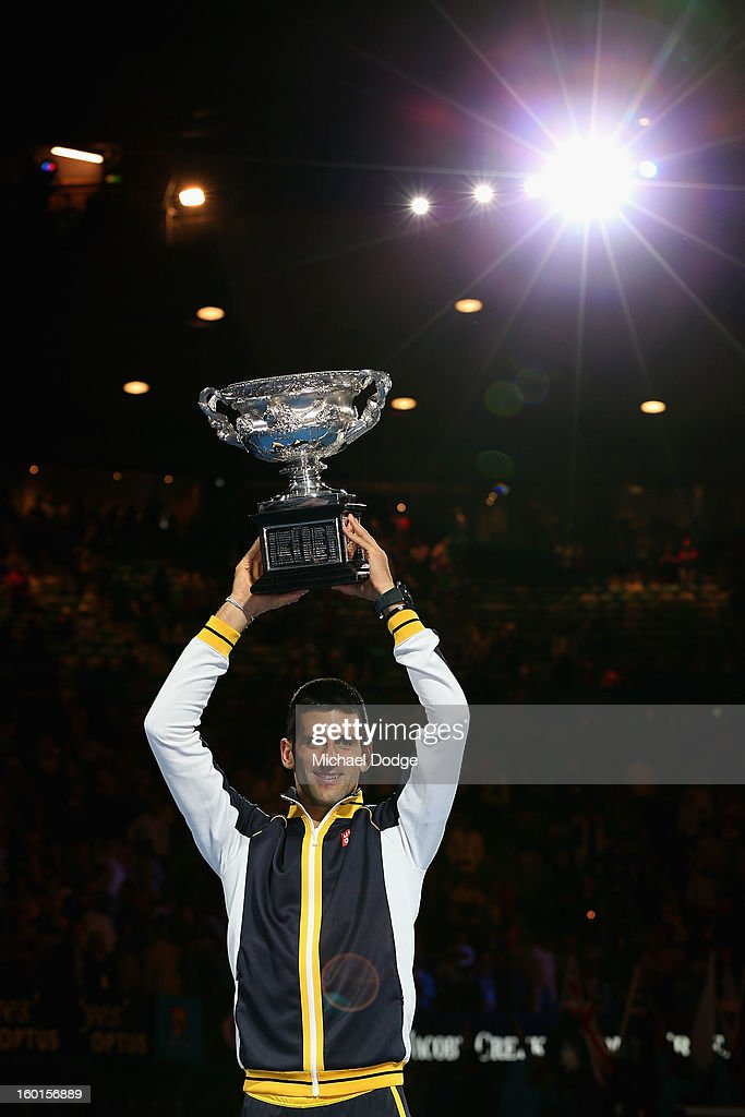 <a gi-track='captionPersonalityLinkClicked' href=/galleries/search?phrase=Novak+Djokovic&family=editorial&specificpeople=588315 ng-click='$event.stopPropagation()'>Novak Djokovic</a> of Serbia holds the Norman Brookes Challenge Cup after winning his men's final match against Andy Murray of Great Britain during day fourteen of the 2013 Australian Open at Melbourne Park on January 27, 2013 in Melbourne, Australia.