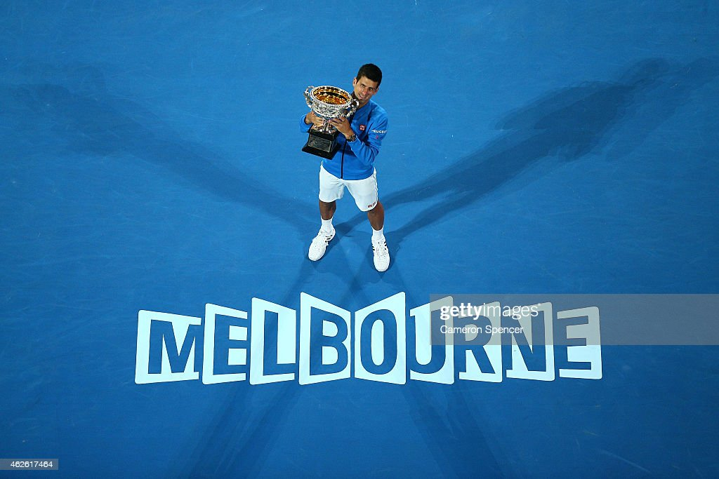 Novak Djokovic of Serbia holds the Norman Brookes Challenge Cup after winning his men's final match against Andy Murray of Great Britain during day 14 of the 2015 Australian Open at Melbourne Park on February 1, 2015 in Melbourne, Australia.