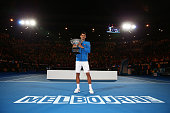Novak Djokovic of Serbia holds the Norman Brookes Challenge Cup after winning his men's final match against Andy Murray of Great Britain during day...