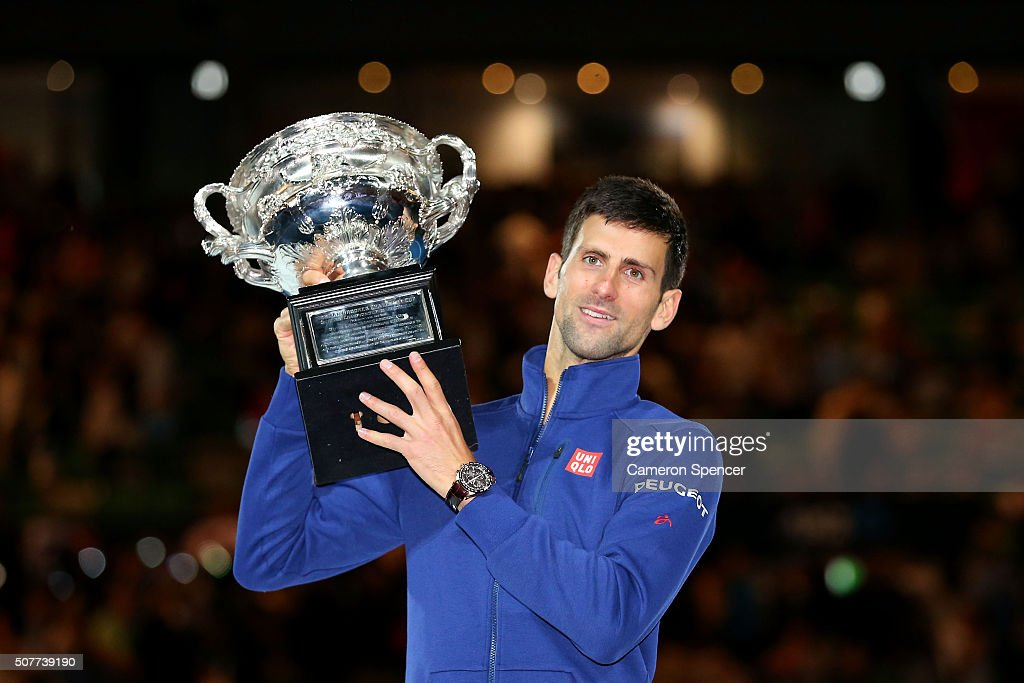 Novak Djokovic of Serbia holds the Norman Brookes Challenge Cup after winning the Men's Singles Final over Andy Murray of Great Britain during day 14 of the 2016 Australian Open at Melbourne Park on January 31, 2016 in Melbourne, Australia.
