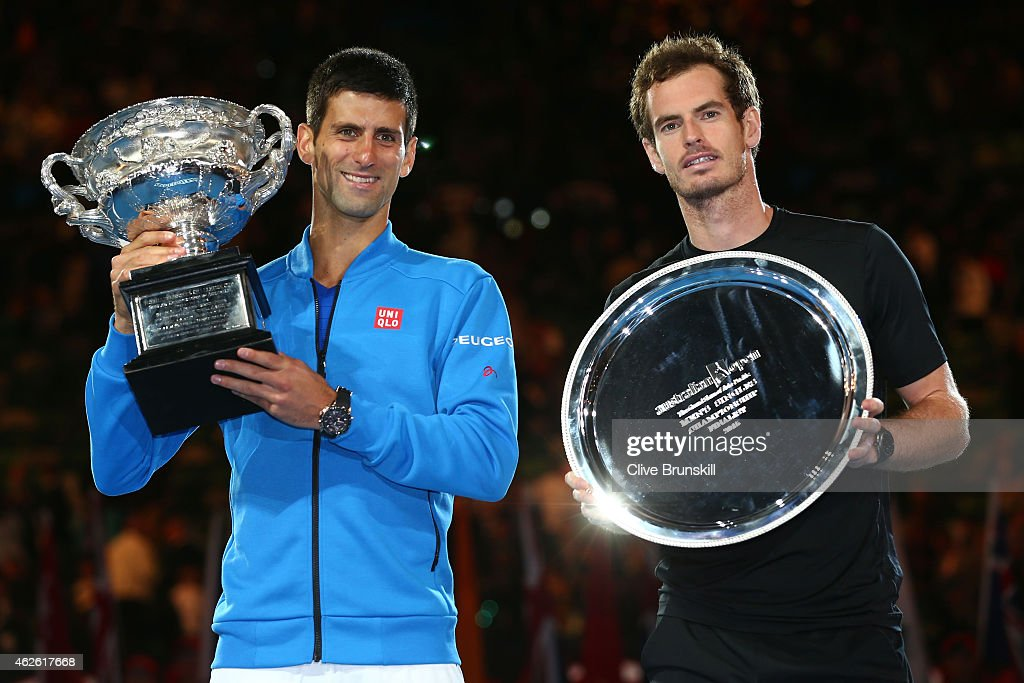 Novak Djokovic of Serbia holds the Norman Brookes Challenge Cup and Andy Murray of Great Britain holds the runner up plate after Novak Djokovic won...