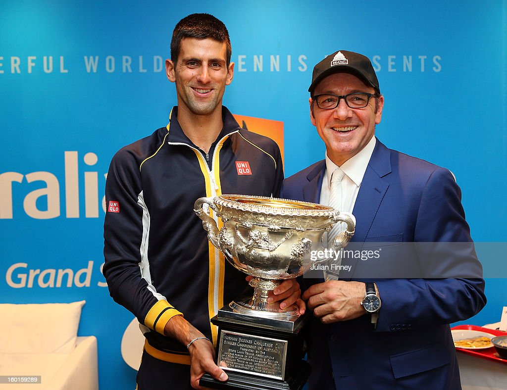 Novak Djokovic of Serbia holds the Norman Brookes Challenge Cup with actor Kevin Spacey in the changerooms after winning his men's final match against Andy Murray of Great Britain during day fourteen of the 2013 Australian Open at Melbourne Park on January 28, 2013 in Melbourne, Australia.