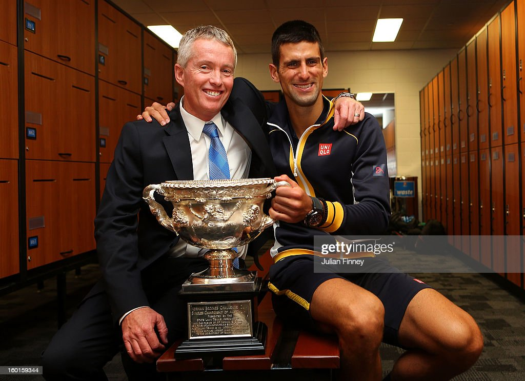 Novak Djokovic of Serbia holds the Norman Brookes Challenge Cup with Craig Tiley in the changerooms after winning his men's final match against Andy Murray of Great Britain during day fourteen of the 2013 Australian Open at Melbourne Park on January 28, 2013 in Melbourne, Australia.