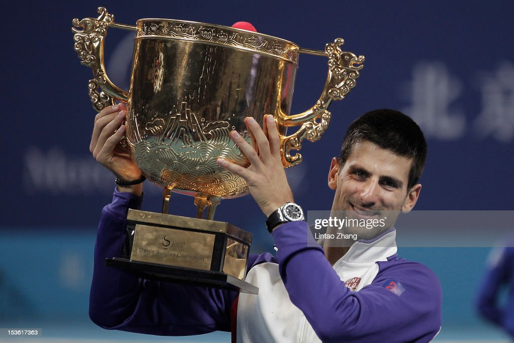 <a gi-track='captionPersonalityLinkClicked' href=/galleries/search?phrase=Novak+Djokovic&family=editorial&specificpeople=588315 ng-click='$event.stopPropagation()'>Novak Djokovic</a> of Serbia holds the trophy aloft after defeating Carlos Jo-Wilfried Tsonga of France in the Men's Singles Final of the China Open at the China National Tennis Center on October 7, 2012 in Beijing, China.