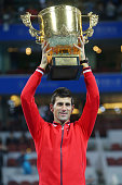 Novak Djokovic of Serbia holds the winners trophy after winning the Mens final against Rafael Nadal of Spain on day 9 of the 2015 China Open at the...