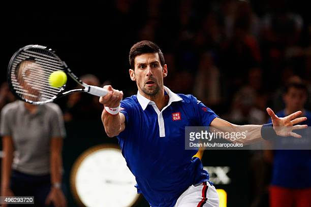Novak Djokovic of Serbia in action against Andy Murray of Great Britain in their Mens Final match during Day 7 of the BNP Paribas Masters held at...