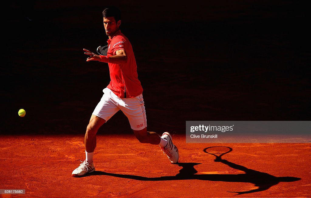 <a gi-track='captionPersonalityLinkClicked' href=/galleries/search?phrase=Novak+Djokovic&family=editorial&specificpeople=588315 ng-click='$event.stopPropagation()'>Novak Djokovic</a> of Serbia in action against Borna Coric of Croatia in their second round match during day five of the Mutua Madrid Open tennis tournament at the Caja Magica on May 04, 2016 in Madrid.