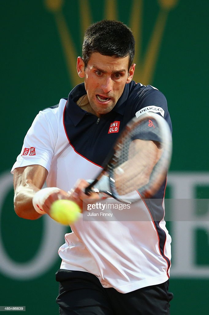 <a gi-track='captionPersonalityLinkClicked' href=/galleries/search?phrase=Novak+Djokovic&family=editorial&specificpeople=588315 ng-click='$event.stopPropagation()'>Novak Djokovic</a> of Serbia in action against Guillermo Garcia-Lopez of Spain during day six of the ATP Monte Carlo Rolex Masters Tennis at Monte-Carlo Sporting Club on April 18, 2014 in Monte-Carlo, Monaco.