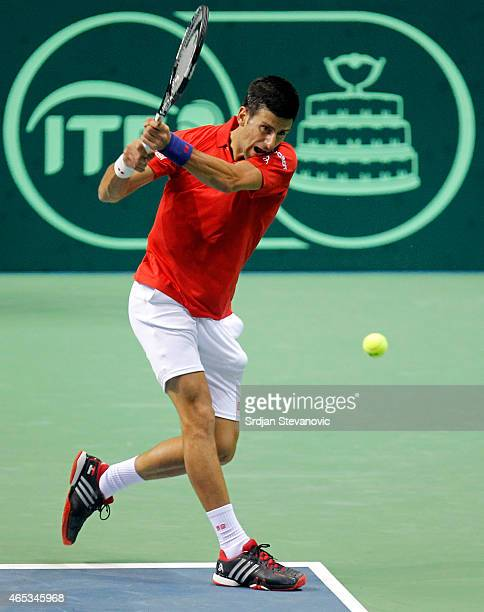 Novak Djokovic of Serbia in action against Mate Delic of Croatia during their men's single match on the day one of the Davis Cup match between Serbia...