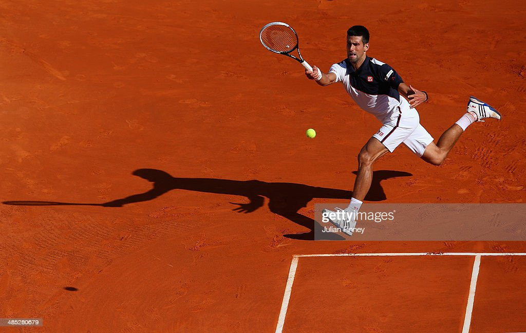 <a gi-track='captionPersonalityLinkClicked' href=/galleries/search?phrase=Novak+Djokovic&family=editorial&specificpeople=588315 ng-click='$event.stopPropagation()'>Novak Djokovic</a> of Serbia in action against Pablo Carreno Busta during day five of the ATP Monte Carlo Rolex Masters Tennis at Monte-Carlo Sporting Club on April 17, 2014 in Monte-Carlo, Monaco.