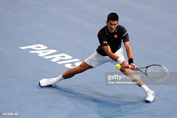 Novak Djokovic of Serbia in action against Philipp Kohlschreiber of Germany during day 2 of the BNP Paribas Masters held at the at Palais Omnisports...
